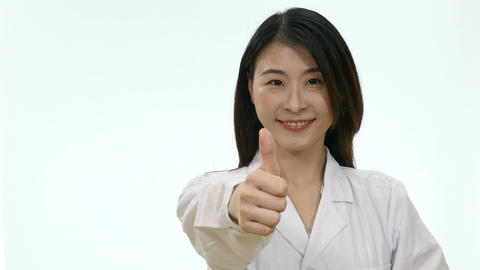 Nurse shows thumbs up on white background Live影片