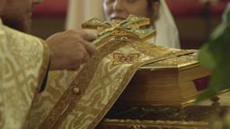 Couple gives vows before God putting their hands on the Bible and swear Footage