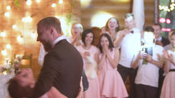 Young beautiful bride and groom dancing first dance at the wedding party GIF