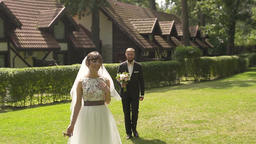 Confident groom meets happy bride first time seeing her in wedding dress Footage