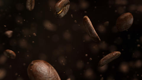 Exploding roasted coffee beans in 4K Stock Video Footage