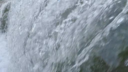 Water river falling in a waterfall or cascade in slow Footage