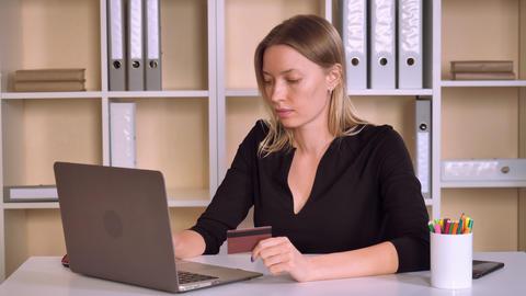 entrepreneur pays bills or booking ticket at workspace Footage