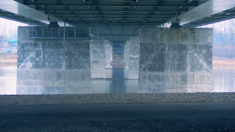 Bridge over the river, concrete columns, the flow of water Footage