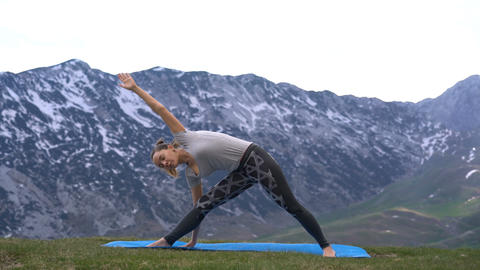 woman practicing yoga outdoors Footage