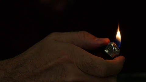 Slow Mo. Lighter sparking many times in male hand. Close up of lighting fire Footage