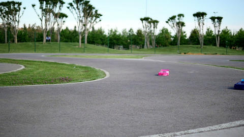 Remote control car racing on race track on a sunny day in Summer. World of Footage