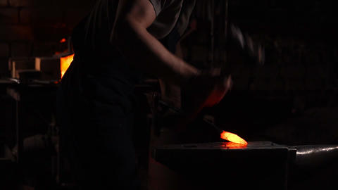 Get hot metal from the furnace to make an arrow tip. Hammer blows on the hot Live Action