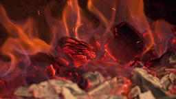 Close-up of burning coals in the stove. Slow motion GIF