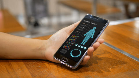 Hands of woman using mobile phone smartphone with Health analysis GIF