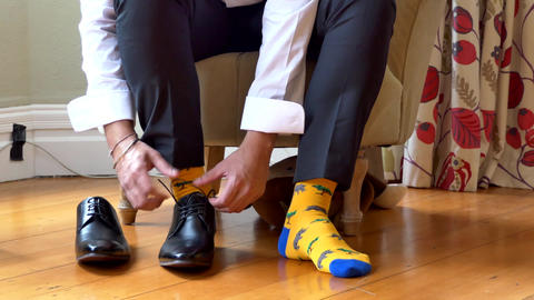 shot of wedding suits, tie, socks, shoes & watches for the groom & groom men Footage