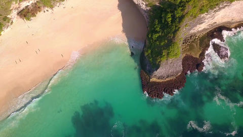 Aerial on stunning tropical paradise beach and cliff in Nusa Penida island of Footage