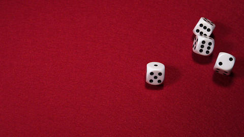 Dice rolling against Red background, slow motion Stock Video Footage