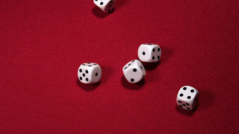 Dice rolling against Red background, slow motion, Live Action