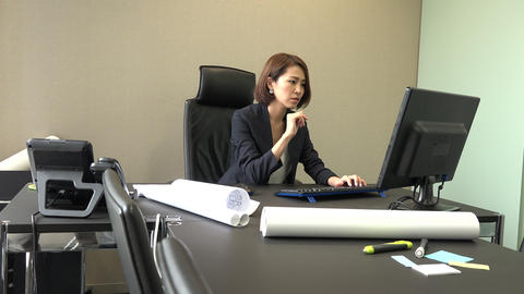 Asian Businesswoman With Computer Working For Career In Office Footage