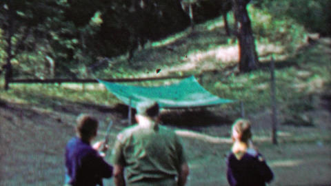 1967: Boy scouts outdoor shooting targets with rifle guns Footage