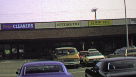1974: Strip mall parking lot business storefront signs and logos Footage
