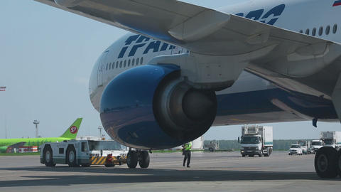 Boeing 777 towed to the parking lot Footage