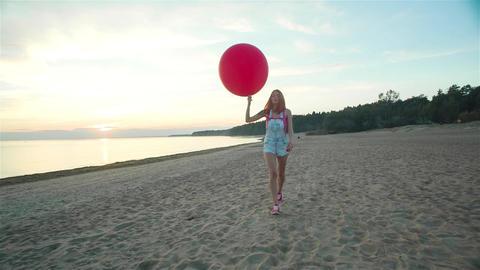 Girl Lets Go A Balloon On The Beach Footage