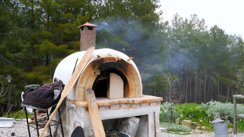brick, clay oven fire outdoor in forest garden background Footage