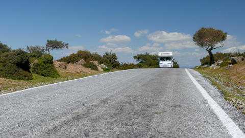 Caravanü camper van on majestic empty road, Assos, Turkey Footage
