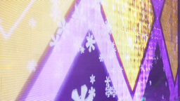 Colourful geometric figures and snowflakes on LED display, close up view Footage