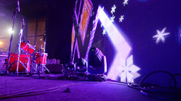 Drum kit, large LED display on stage with colourful animation flash over Footage