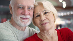 Portrait of smiling senior couple in love. Happy family standing and hugging at Footage