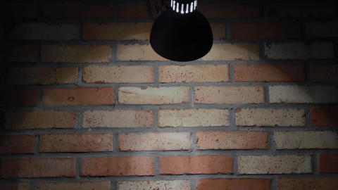 The incandescent lamp shines on a brick wall, the texture of a brick 영상물