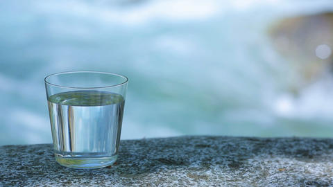 A glass with clear water, mountain river Footage