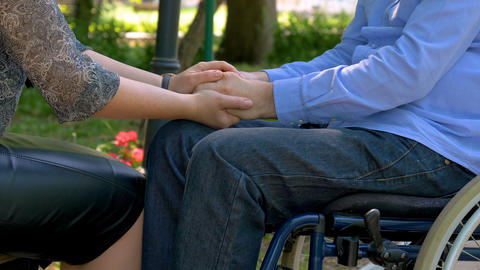 Disabled young man encouraged by his wife outdoors 영상물