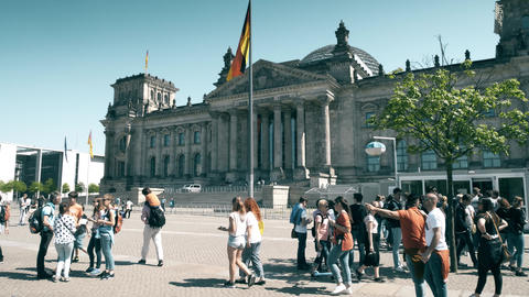 BERLIN, GERMANY - APRIL 30, 2018. Tourists in line to enter the Reichstag or Footage