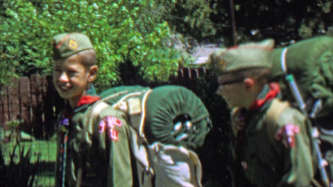 1967: Boyscouts friends loaded packs ready for big camping trip Footage