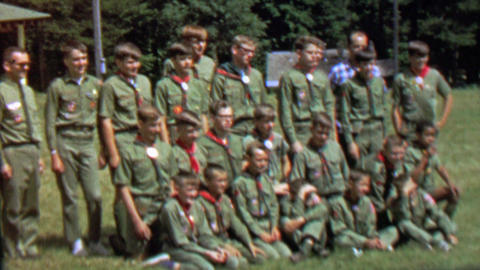 1967: Boy scout troop poses group picture lawn green outfit Footage
