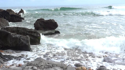 Waves that burst the rocky shore forming foams and bubbles 29 Footage