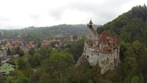Aerial image of a castle built on a rock at the edge of a village 6 Footage