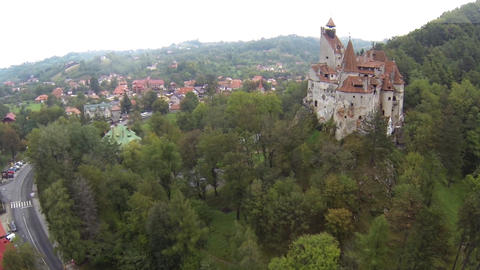 Aerial image of a castle built on a rock at the edge of a village 5 Footage