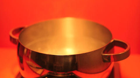 Cooking Hot Water In A Pot stock footage