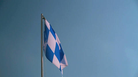 Bavarian flag in front of a blue sky Footage