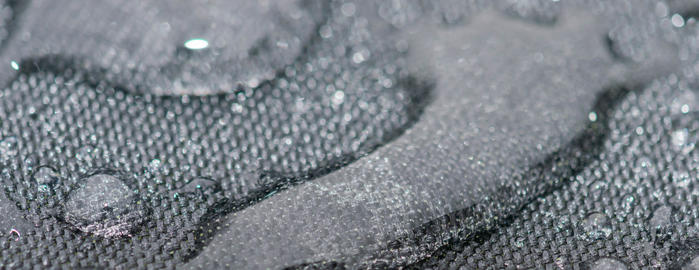 Closeup detailed view of raindrops on a fabric, a background Photo