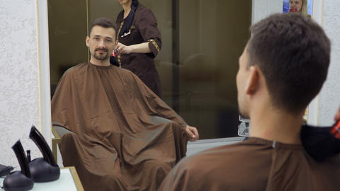 Hairdresser cleans man's neck after cutting hair Footage