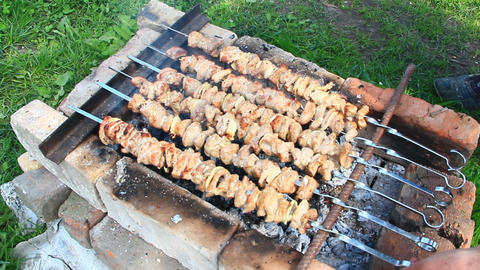 Barbecue lunch outdoors. Process of cooking pork meat on fire. Shashlik prepared Footage