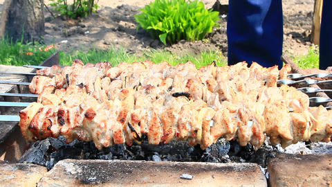 Appetizing shashlik outside. Cooking of pork meat. Barbecue lunch outdoors Footage