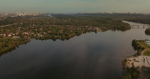 Aerial View. Flight over the river overlooking the bridge city. Sunny Day Footage
