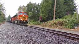 Freight train with cargo containers passing by Footage