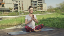 Young woman doing yoga near home Footage