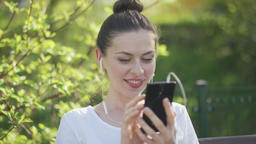Enthusiastic woman texting on smartphone Footage