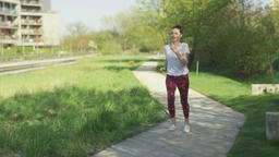 Woman running in park in the morning Footage