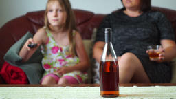 Mother is Drinking Alcohol and is watching Tv with her daughter 02 Footage