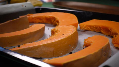 the chef sprinkles pumpkin slices with black pepper Footage